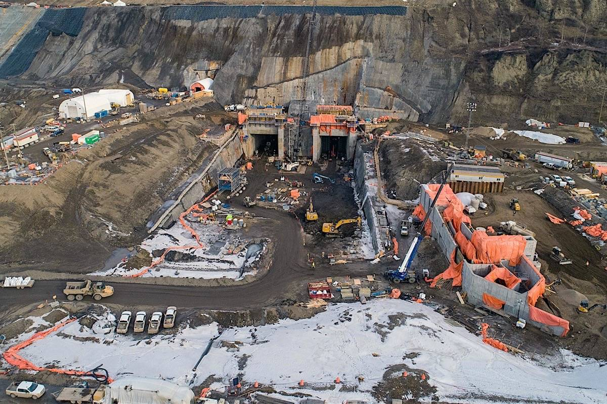 FILE – Diversion tunnels have been completed to redirect the Peace River during low water this summer, in one of the most critical steps to completing the Site C dam, March 2020. (BC Hydro)